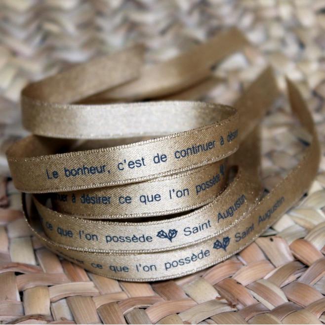 """Ruban doré """"le bonheur, c'est de continuer à désirer ce que l'on possède"""" Saint Augustin"""